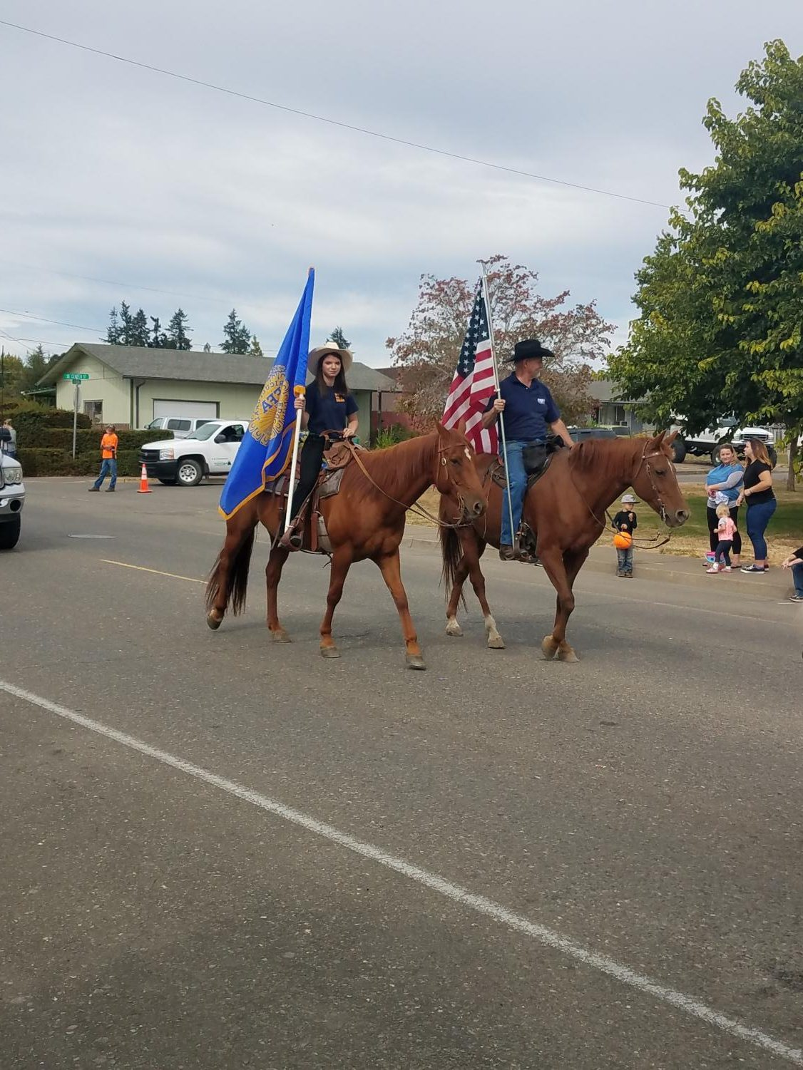 Former+WMS+student+and+current+DHS+student%2C+Whitney+Evans+carries+the+flag+on+horseback+during+the+parade.+